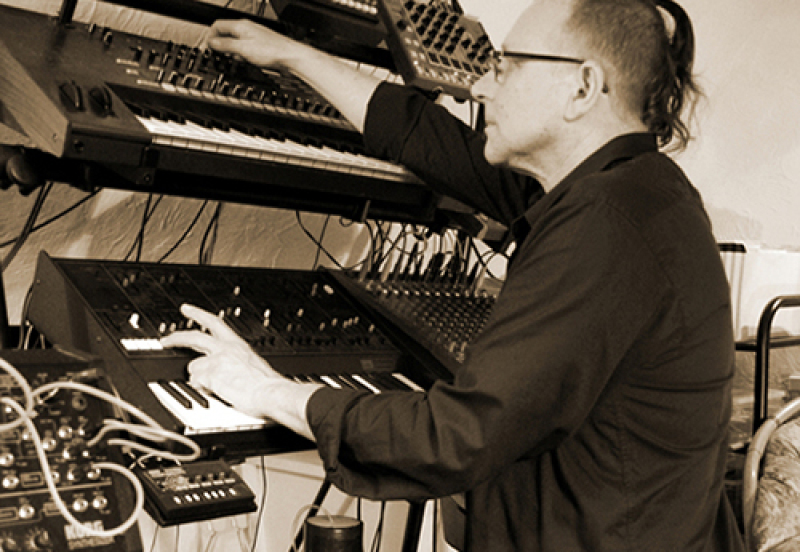 Paul Zawadzki playing keyboards in studio