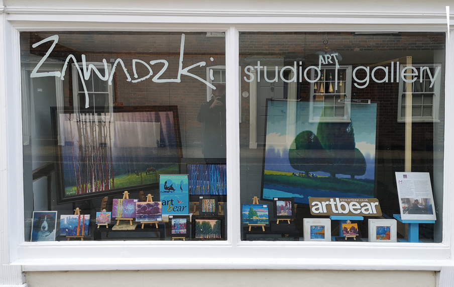 paintings on dosplay in Zawadzki studio | gallery window