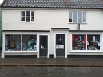 Zawadzki gallery and D fur dogs groomers window view from street