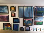 gallery view from inside with paintings on display wall
