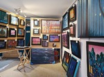 gallery view from inside with paintings on display panels